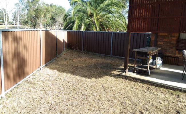 Backyard storage behind gate