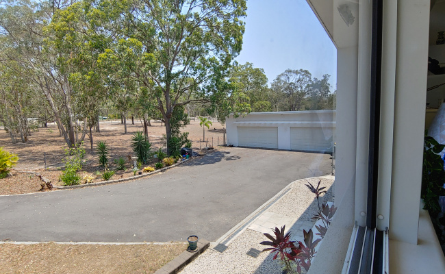 Driveway parking on Barranjoey Drive in Sunshine Acres QLD