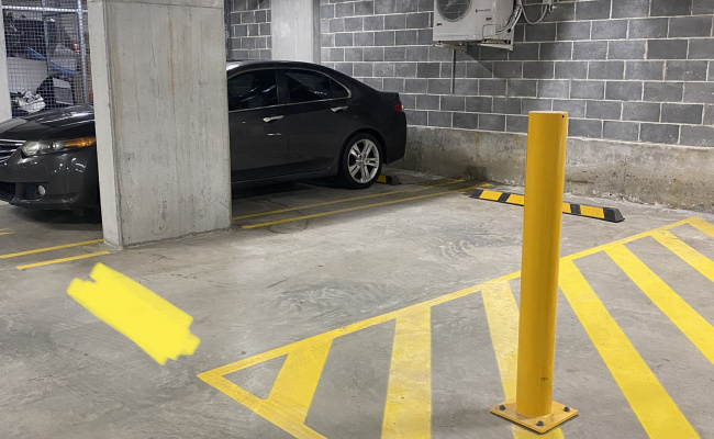 Underground secure car parking space in Olympic Park / Lidcombe