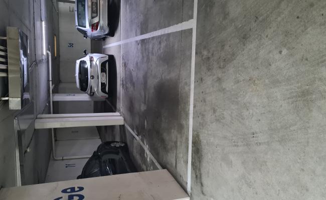 Secure Beach Front Carpark in Swipe Accessed Garage.