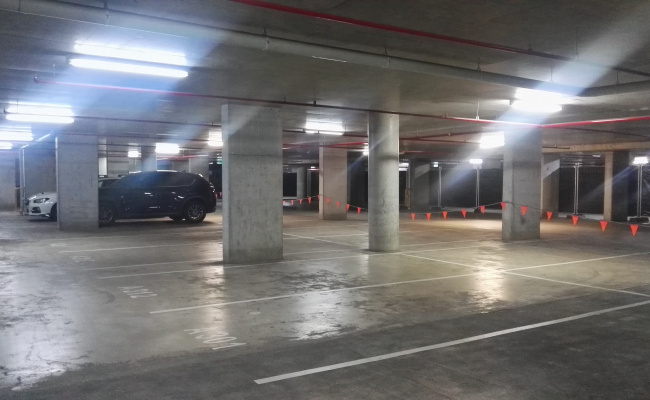 Secure 24/7 parking spot close to transport with lift access