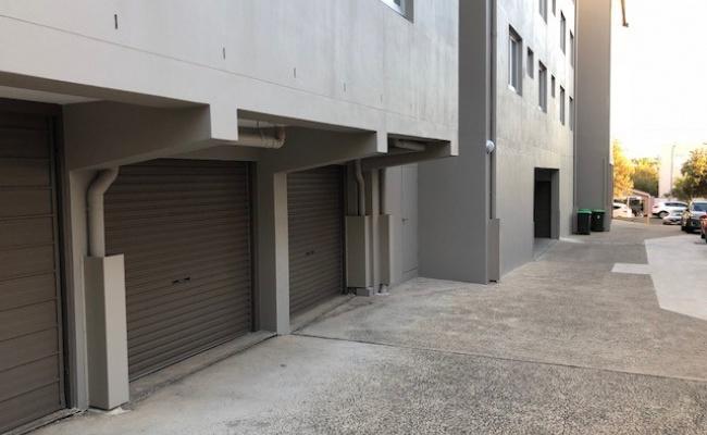 Lock up garage with auto lift door and rear door.